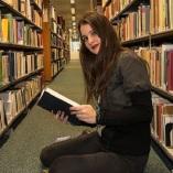 student at bookshelves